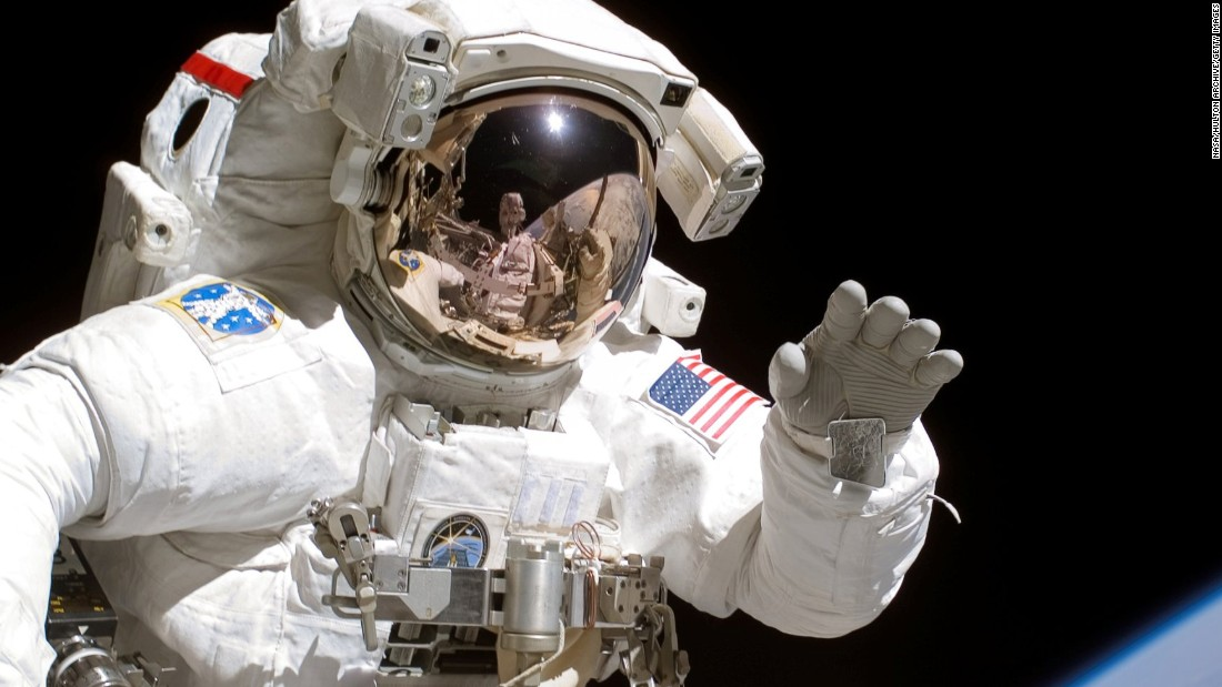 an astronaut goes out for a space walk - photo #15