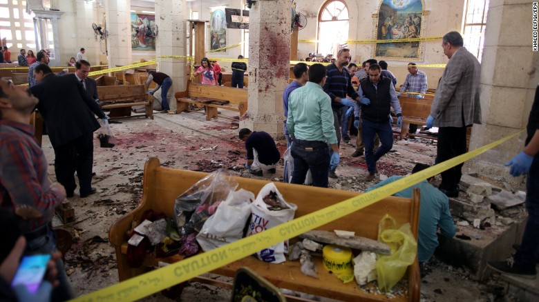 Security personnel investigate the scene of a bomb blast at St. George's Church in Tanta, Egypt, on Palm Sunday.