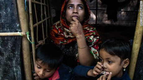 Mohsena, 22, is seen in front of her shelter with her two children.