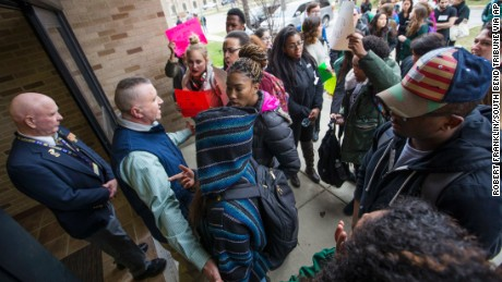 Police and officials block protesters from a University of Notre Dame hall where Charles Murray was speaking March 28.