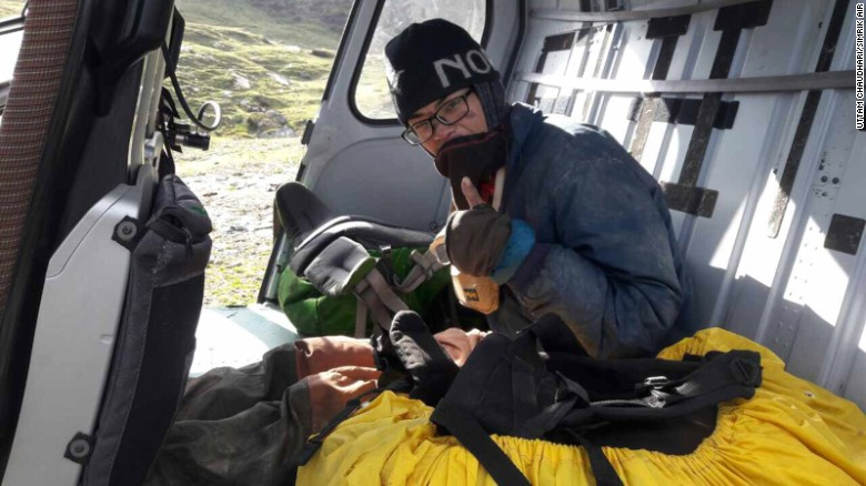 Survivor Liang Sheng-yue was found conscious and with the remains of his partner, Liu Chen-chun, just before midday Wednesday and airlifted out of a ravine near the Narchet River in the Himalayas.