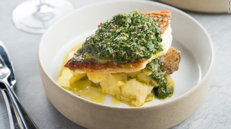 Lilia's black bass with salsa verde and coal-roasted potatoes.