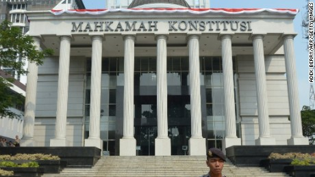 An Indonesian policeman stands guard outside the Constitutional Court in Jakarta in August 2014.