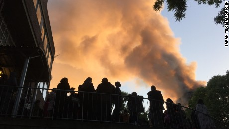 Residents of Whitchurch road watch smoke billowing from the tower.