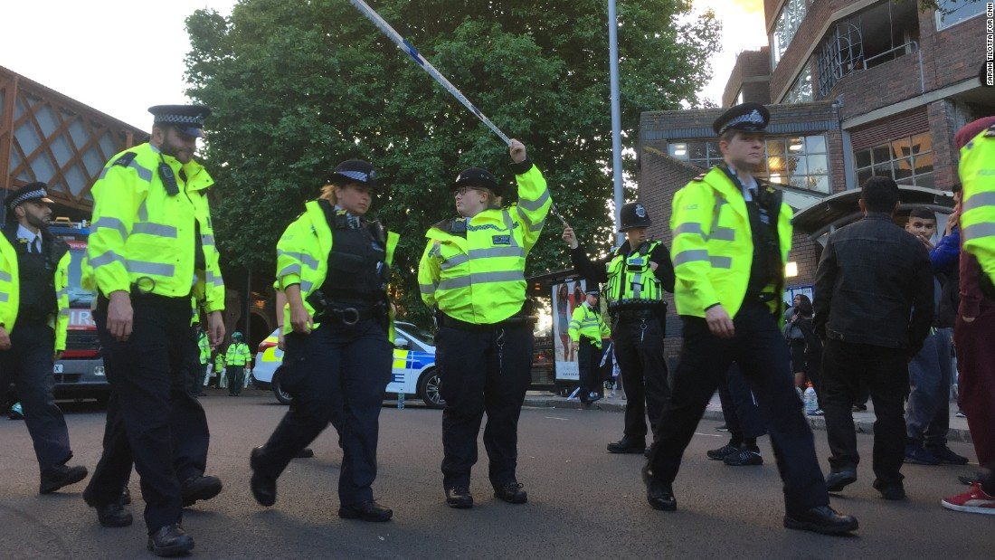 Police officers on nearby Bradley Road asked people to step back so they could expand the cordon and make more space for emergency services.