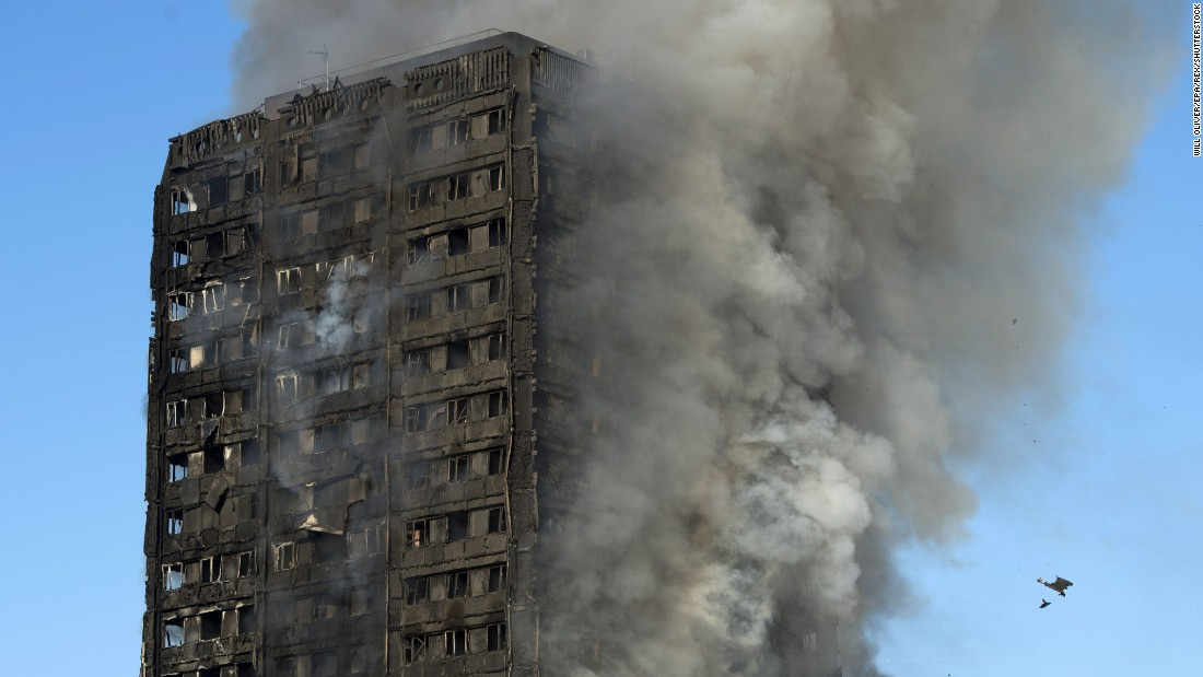 Smoke rises from the fire at the Grenfell Tower apartment block in North Kensington, London, on Wednesday, June 14. According to the London Fire Brigade, 40 fire engines and 200 firefighters are working to put out the blaze. Residents in the tower were said to be evacuating and a number of people were treated for a quot;range of injuries,quot; Metropolitan Police said.