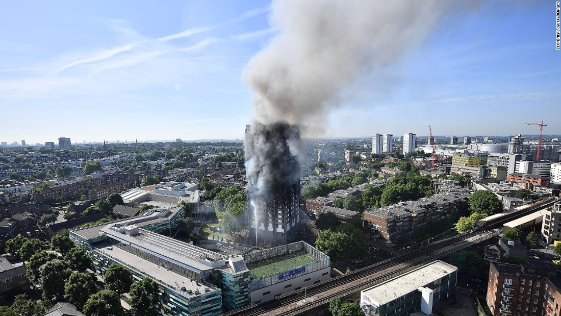 Smoke rises from the Grenfell Tower after a fire engulfed the building in the early morning hours.