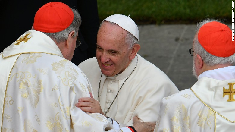 Pope Francis greets Cardinal George Pell at the Vatican in  November 2016.