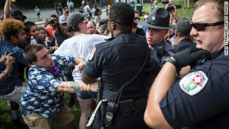 Officers clash with counterprotesters who turned out in reaction to a KKK rally.