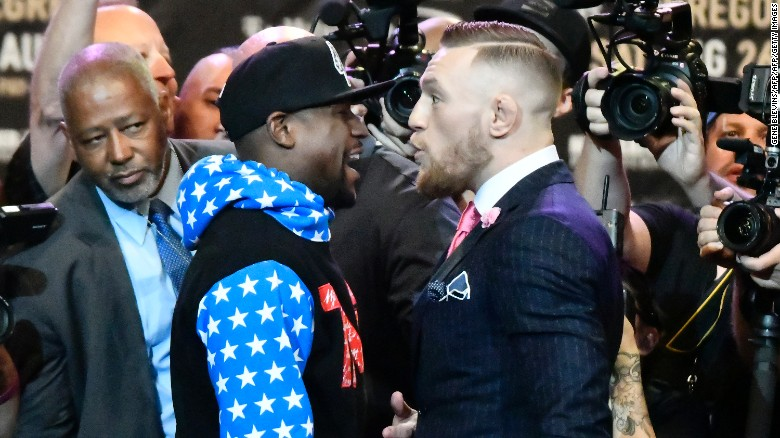The promotional tour also took in Los Angeles ... McGregor mocked Mayweather's decision to wear a tracksuit that event.