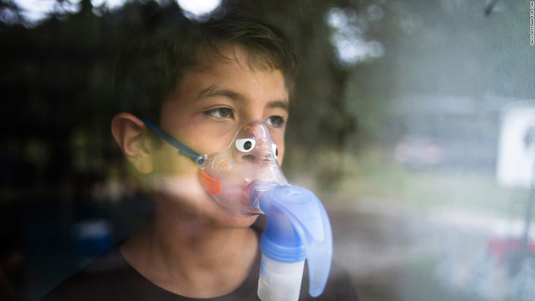 Alejandro Rodriguez wears a nebulizer mask to help him breathe. After he filed a lawsuit, the state put him back on Children's Medical Services.