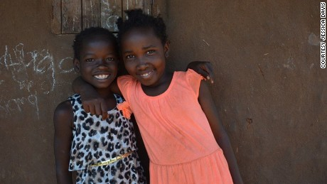 "Mata, left, and Violah met up in the village after their return. ""The only trauma this poor kid ever experienced,"" says Mata's adoptive father, Adam Davis, ""was because we essentially placed an order for a child."""