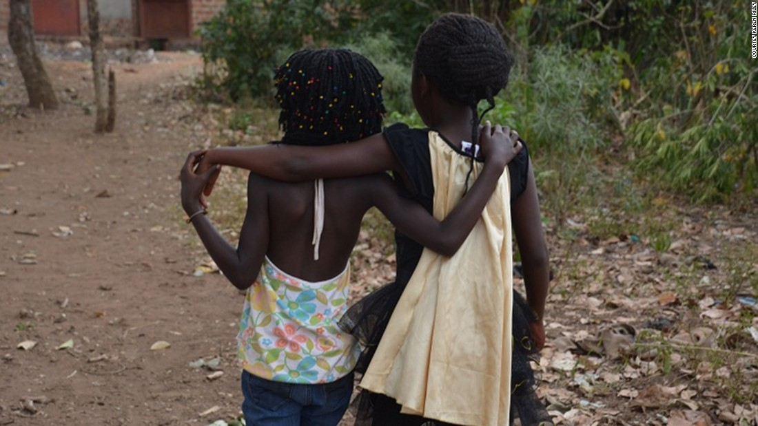 Mata, left, and Violah were taken from the same village and adopted by two US families. After they were returned to their mothers, the girls became fast friends.