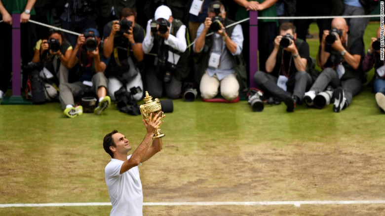 Roger Federer of Switzerland celebrates his eighth singles title at Wimbledon on July 16, 2017. Federer beat Croatia's Marin Cilic, 6-3, 6-1, 6-4.