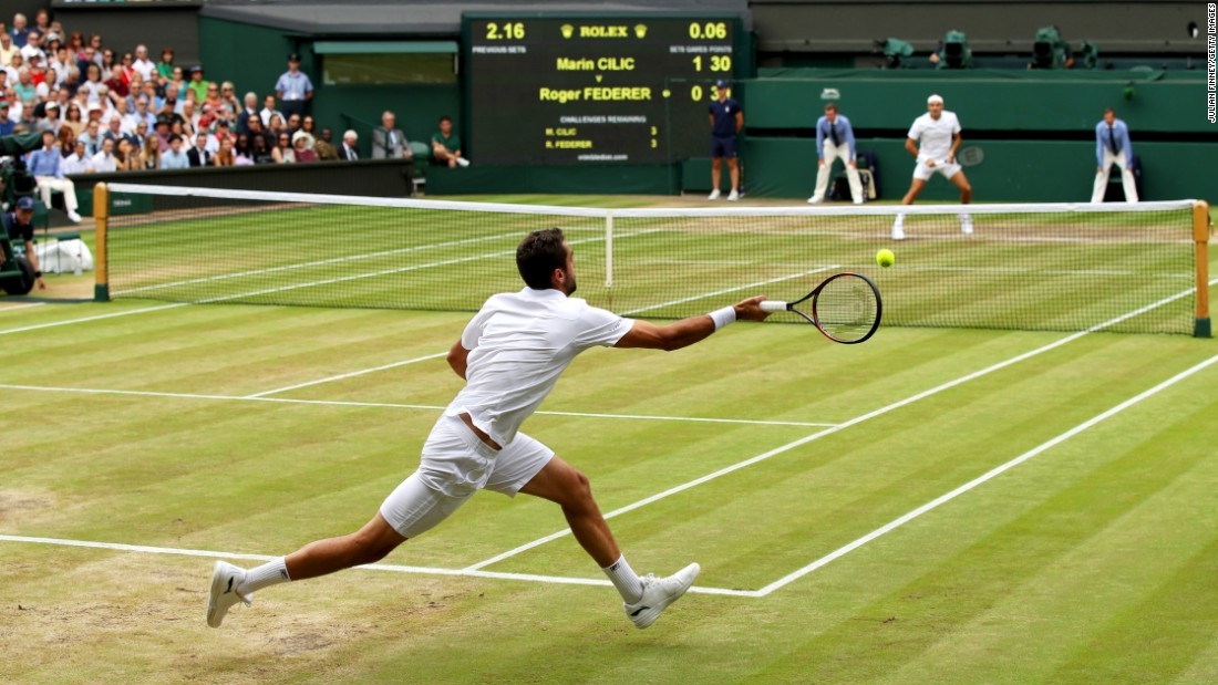 Cilic plays a running forehand.
