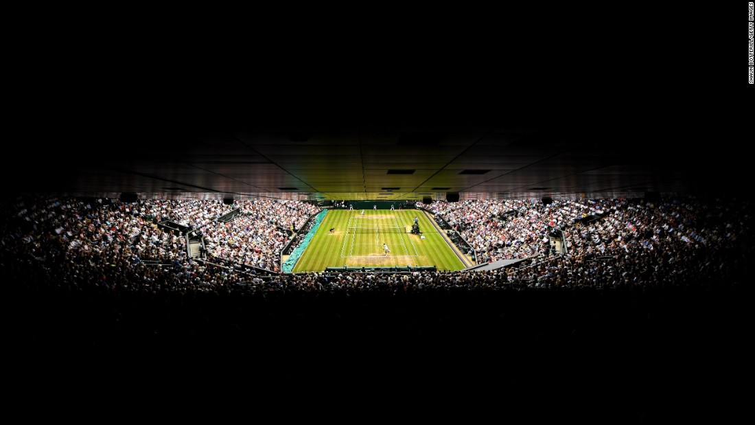 Federer and Cilic entertain a packed Centre Court during the men's final on day 13 of  Wimbledon.