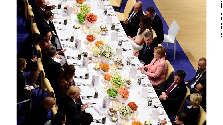 Russian President Vladimir Putin seen top right, next to US First Lady Melania Trump at a banquet during the G20 Summit in Hamburg.