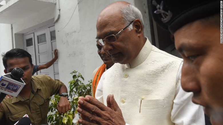 Ram Nath Kovind, center, gestures as he leaves his residence in New Delhi on June 20, 2017.