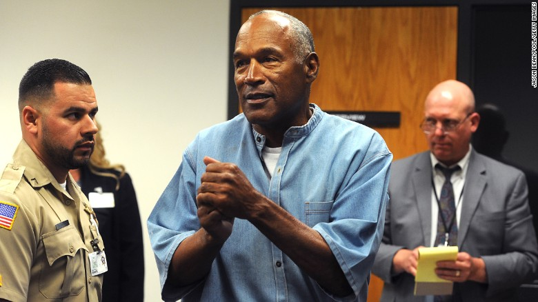 O.J. Simpson reacts after learning he was granted parole at Lovelock Correctional Center on Thursday, July 20, in Lovelock, Nevada. Simpson is serving a nine-to-33-year prison term for a 2007 armed robbery and kidnapping conviction. Click through the gallery to see moments from the notable life of the former football and media star.