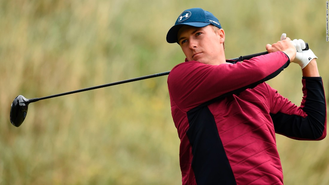 Spieth weathered strong winds and heavy rain to lead the British Open by two shots at halfway at Royal Birkdale.