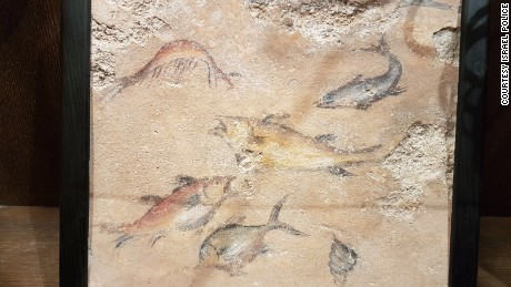 A luxurious wall mural depicting fish seized in the raids.