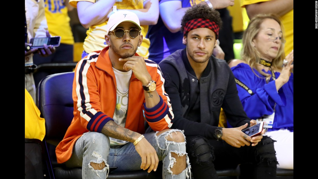 Neymar sits next to another world-famous athlete -- Formula One champion Lewis Hamilton -- while attending Game 2 of the NBA Finals in June.