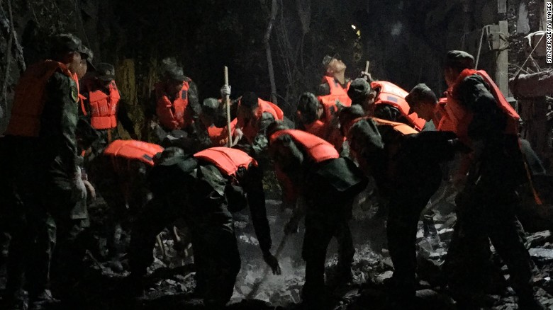 Chinese paramilitary police search for survivors after an earthquake in Jiuzhaigou in southwest China's Sichuan province early on August 9.