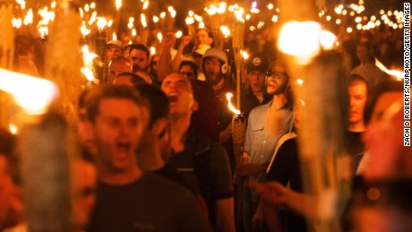 """White supremacists and others march through the University of Virginia capus on Friday night, the day before a """"Unite the Right"""" rally in Charlottesville."""