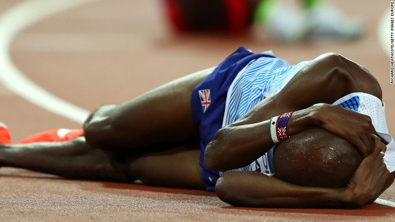 Britain's Mo Farah slumps to the track in disappointment after failing in his bid for gold in the 5,000m at the world athletics championship in London.