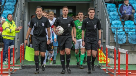 Atkin (center) will work as a fourth official in Football League games this season.
