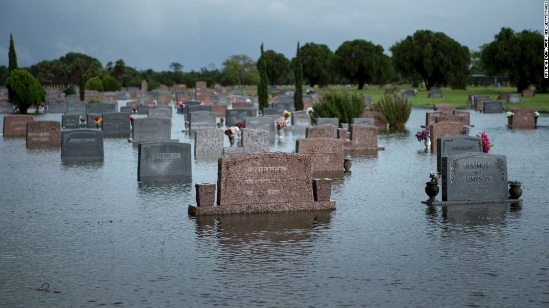 A graveyard is flooded in Pearland, Texas, on August 27.