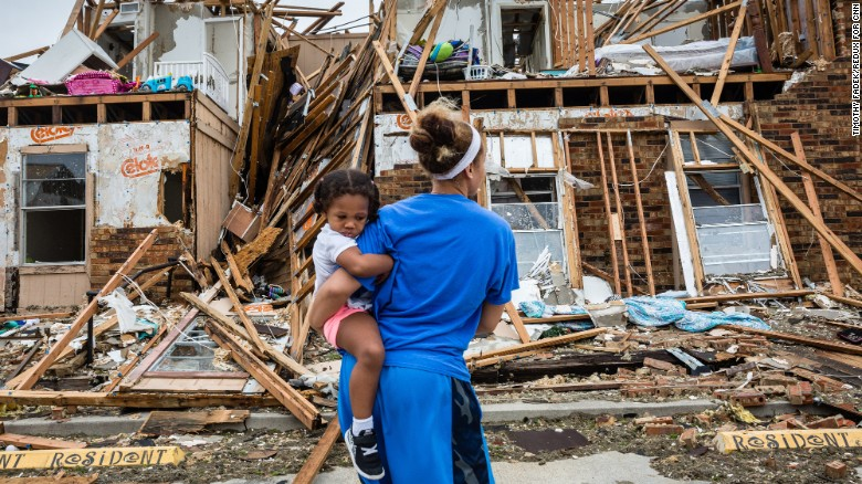 Residents of Rockport, Texas, return to their destroyed home on August 27.