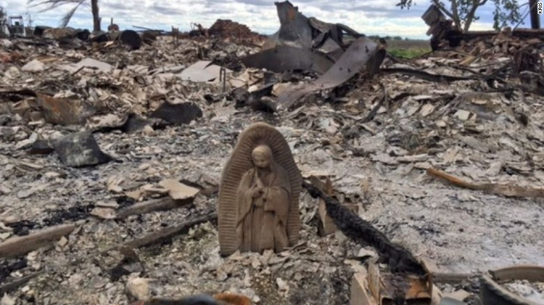 """Texas woman after returning to burned home: """"This statue is the only thing that survived."""""""