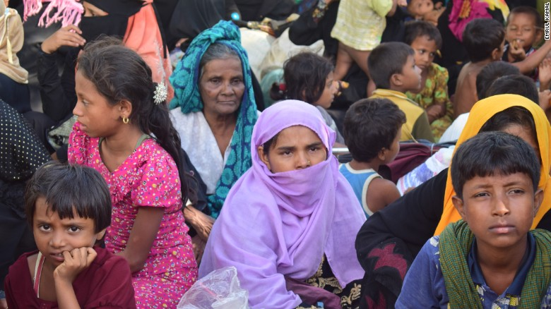 Rohingya woman Sayra Begum, wearing purple, sits with her relatives at a shelter in Cox's Bazar.