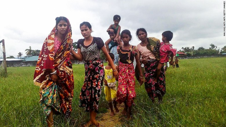 Women and children fleeing violence in their villages arrive at the Yathae Taung township in Rakhine State in Myanmar on August 26, 2017.