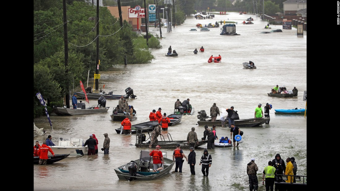 Rescue boats fill Tidwell Road in Houston as they help flood victims evacuate the area on August 28.