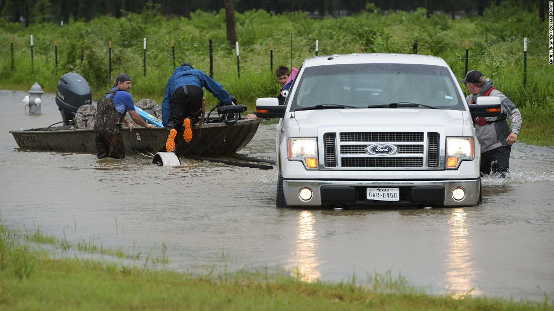 Civilian rescuers put a boat into a flooded road to search for people in Cypress on August 29.