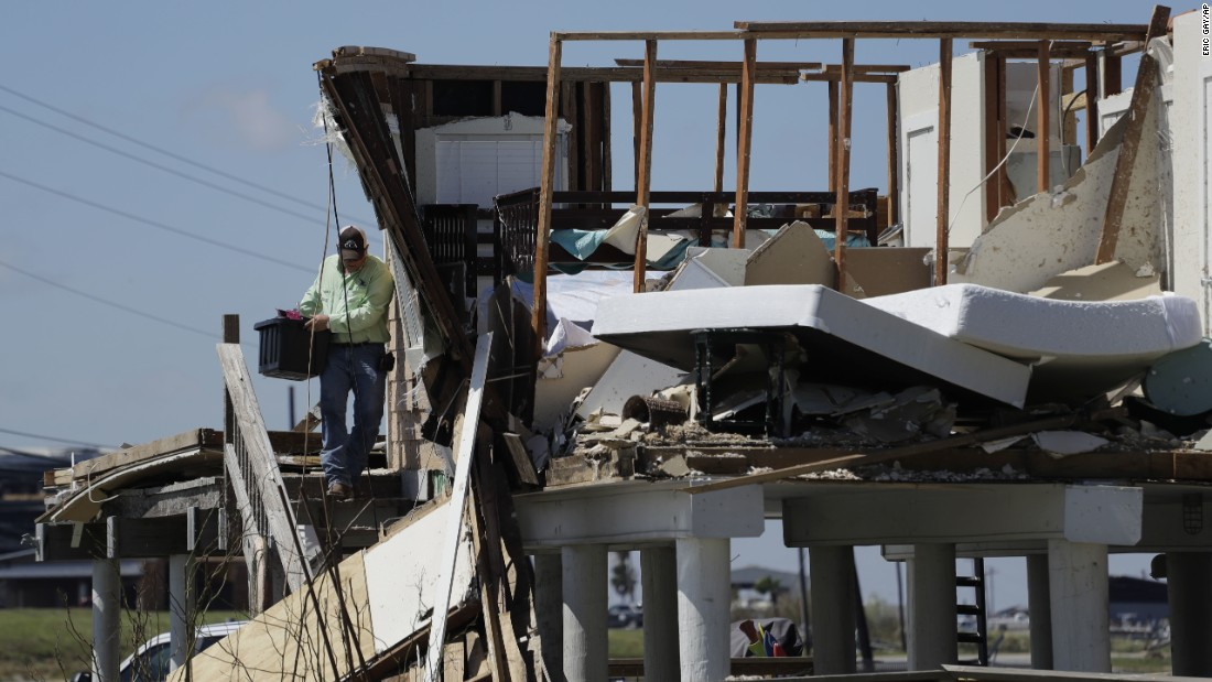 Shane Johnson removes items from a family home in Rockport, Texas, on August 29.