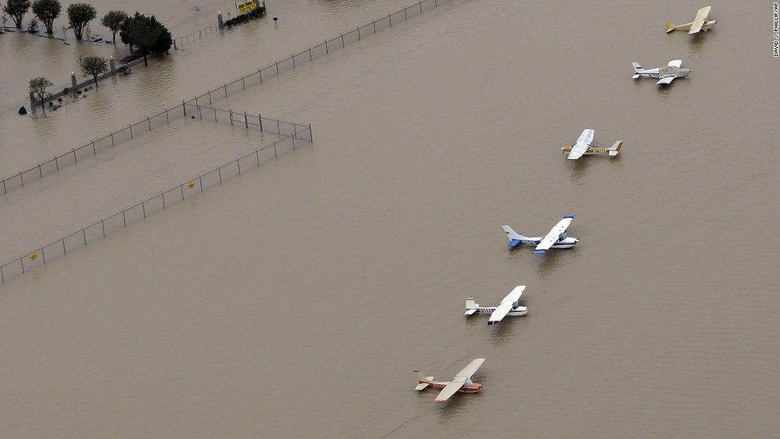 Airplanes sit at a flooded airport in Houston on August 29.
