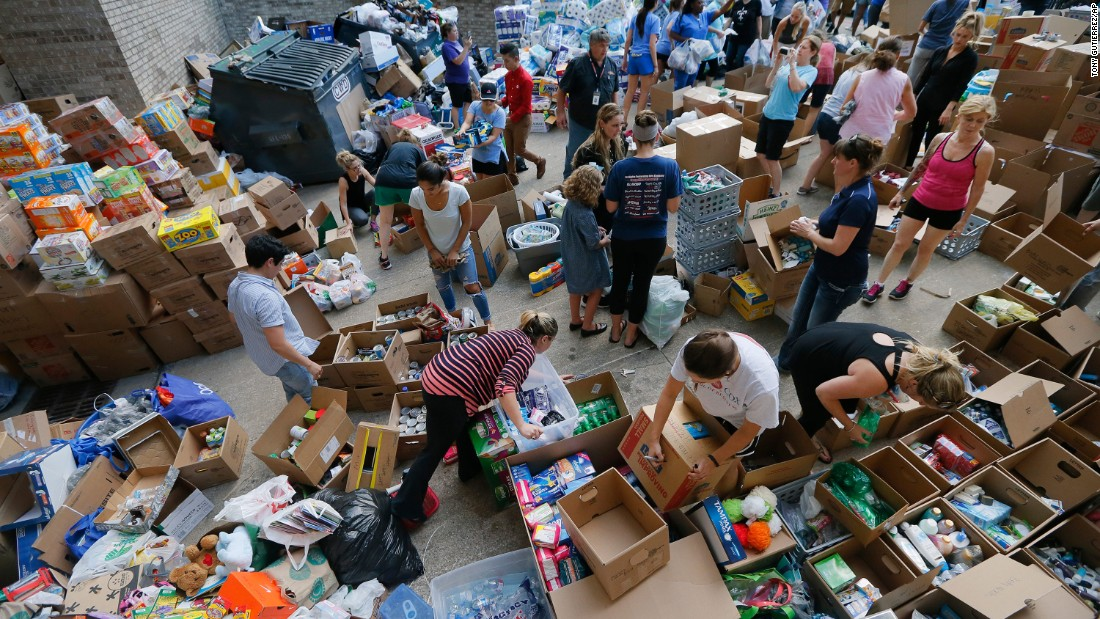 Volunteers organize items donated for Hurricane Harvey victims in Dallas on August 29.