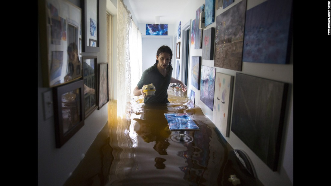 Matthew Koser searches for important papers and heirlooms inside his grandfather's house in Houston's Bear Creek neighborhood on August 29. The neighborhood flooded after water was released from nearby Addicks Reservoir.