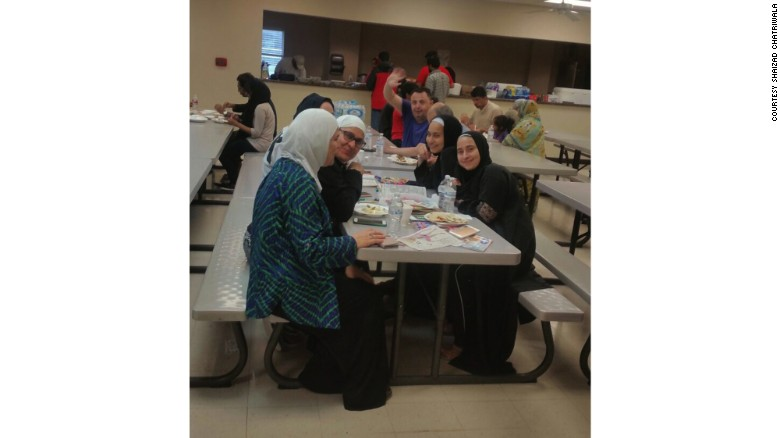 Evacuees eat at the Brand Lane Islamic Center in Stafford, Texas.