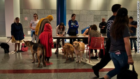 Evacuees have been able to bring their pets to a temporary shelter in downtown Houston's George R. Brown Convention Center, which has more than 10,000 people.