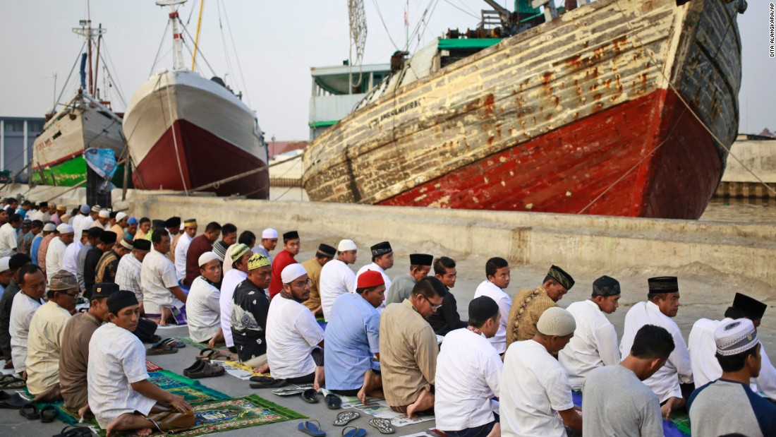 Muslim men attend a morning prayer marking Eid al-Adha at Sunda Kelapa port in Jakarta, Indonesia on Friday.