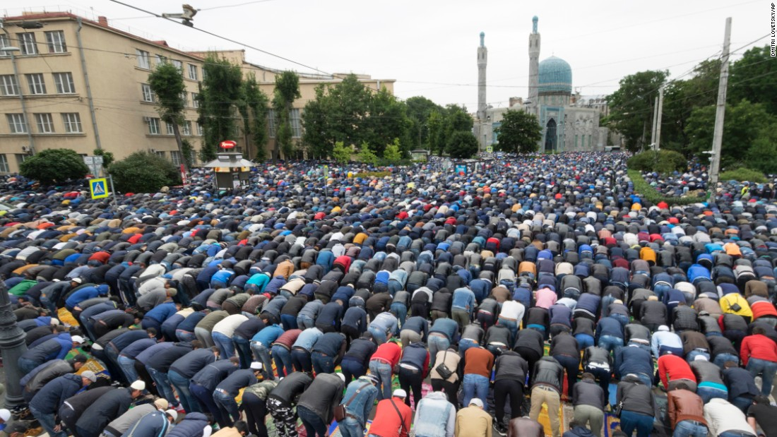 Muslims pray outside a mosque in St. Petersburg, Russia on Friday.