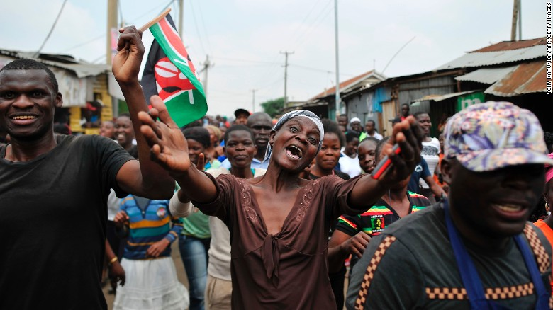 Supporters of Kenya's opposition leader Raila Odinga celebrate in the streets of Nairobi on Friday.