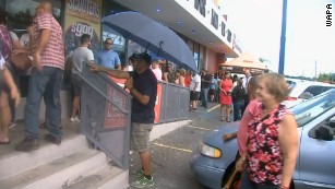 Crowds wait outside a store in Puerto Rico as Hurricane Irma nears.
