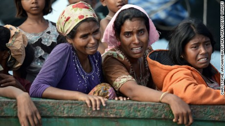 Rohingya migrant women cry, stranded on a boat drifting in Thai waters on May 14, 2015.