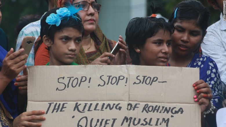 Children hold a placard calling on Myanmar to stop the killing of Rohingya Muslims, during a rally in Dhaka on September 8.