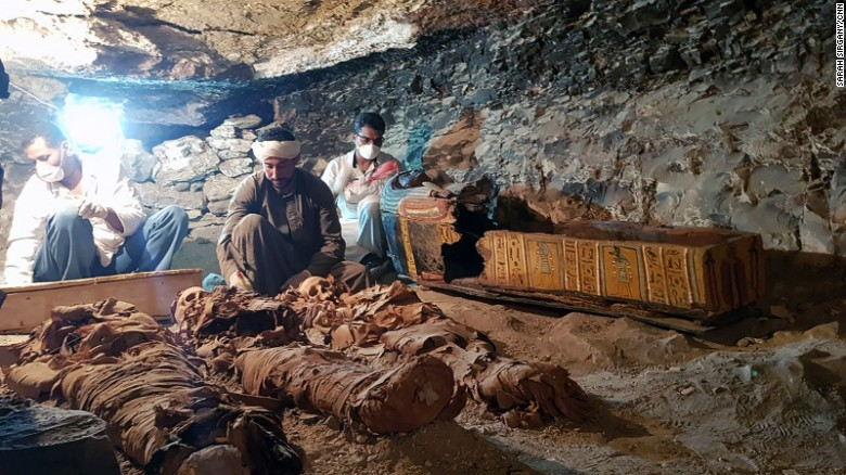 Researchers examine the tomb on Saturday.